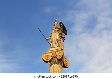Athena Statue at the National Academy of Arts in Athens, Greece with blue sky copy space.