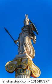 Athena statue on blue sky background in Athens, Greece. Athena was the ancient Greek goddess of knowledge and wisdom.
