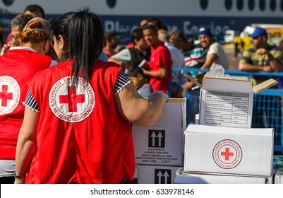 Athens APRIL 15: Red Cross mission gives food and water for refugees in a refugee camp in the Greek port  April 15, 2016 in Athens.