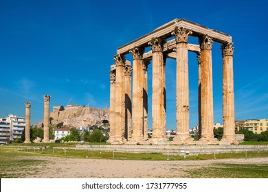 Athens, Attica / Greece - 2018/04/03: Panoramic view of Temple of Olympian Zeus, known as Olympieion at Leof Andrea Siggrou street in ancient city center old town borough with Acropolis in backgrund