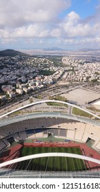 Athens, Attica / Greece - 28 October 2018: Aerial drone photo of iconic Olympic stadium and public facilities in Kalogreza called OAKA designed by Santiago Calatrava with beautiful clouds and blue sky