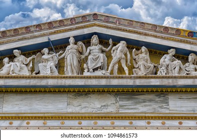 Athens, Attica - Greece. Detail of the multi-figure pediment sculpture, on the theme of the birth of godess Athena on the facade of the main neo-classical building of the Academy of Athens. Cloudy sky