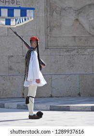 Athens, Attica / Greece - January 20 2-2019: Extreme zoom photo of Evzones dressed with National traditional uniform guard the Greek Parliament with great honour