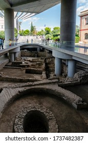 Athens, Attica / Greece - Oct 21, 2018: Ancient ruins at the archaeological site right in front of the entrance of the modern Acropolis Museum in Athens city in Dionysiou Areopagitou Street