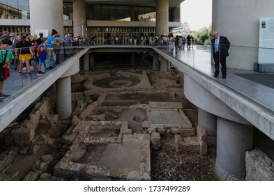Athens, Attica / Greece - Oct 21, 2018: Exterior view of the modern Acropolis Museum in Athens in Dionysiou Areopagitou street. Visitors are looking the ancient ruins in front of the museum.