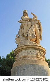 Athens, Attica, Greece – October 17, 2018:  Public XIX century sculpture of the famous British poet Lord Byron crowned by personification of Greece in the National Garden in Athens, Greece with blue s