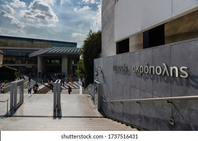 """Athens, Attica / Greece - October 21, 2018: Exterior view of the new Acropolis Museum in Athens (Dionysiou Areopagitou Street). Sunny day, cloudy sky. """"Acropolis Museum"""" in greek language signage"""