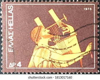 Athens, circa 1975: Canadian used stamp from the musical instruments series depicting Cithern-player (from amphora).