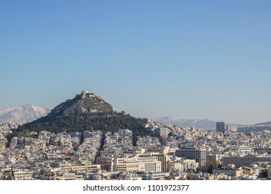 Athens city view with Lycabettus hill in the background, Athens, Greece. Lycabettos