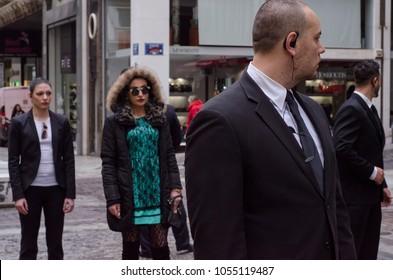 ATHENS, ERMOU,GREECE FEBRARY 5 2016:bodyguard headset, escort service on road