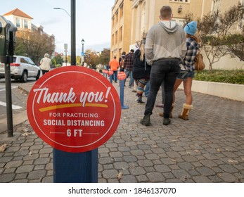 Athens, GA, United States: October 21, 2020: Thank You for Social Distancing At The Polls Sign with waiting line