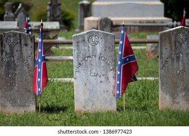 Athens, Georgia – May 2, 2019: Stones marking the graves of some of the unknown dead of the Confederate States of America stand near a memorial in their honor at the entrance to Oconee Hill Cemetery.