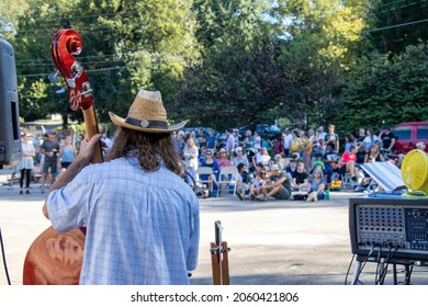 Athens, Georgia - October 10, 2021: Bassist Dan Horowitz looks out at the crowd as Klezmer Local 42 plays at the Jittery Joe's Roaster during the annual Boo-Le-Bark fundraising event for AthensPets.