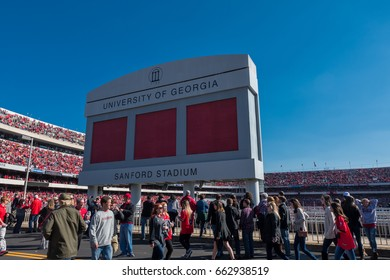 Athens, Georgia, United States: November 26, 2017: Crowd passes under Sanford Stadium Sign on Game Day