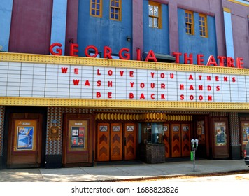 ATHENS, GEORGIA, USA - MARCH 31, 2020: Famous Athens Georgia Theatre closed due to the Coronavirus outbreak. Showing sign expressing love for Athens and will be back soon.