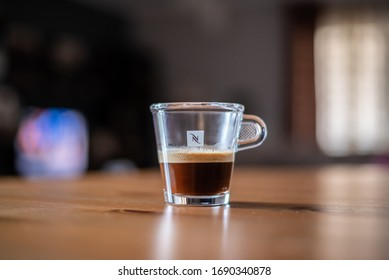 ATHENS, GREECE, 01 APR 2020 : Transparent Nespresso glass of coffee on a table with blurred background