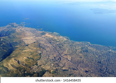 ATHENS, GREECE -2 JUN 2019- Aerial view of the city of Athens, including the old decommissioned Ellinikon Athens airport and the Saronic Gulf.