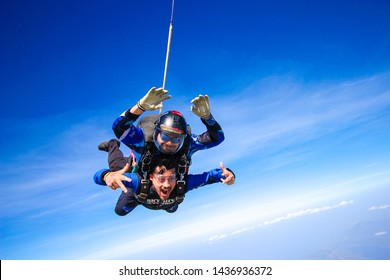Athens, Greece, 2019- A view of Tandem Skydive with instructor and tourist attached to each other and enjoying a free fall at a top speed of 225 kms/ hr