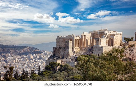 Athens, Greece. Acropolis propylaea propylea or propylaia entrance gateway and monument Agrippa pedestal, view from Philopappos Hill.