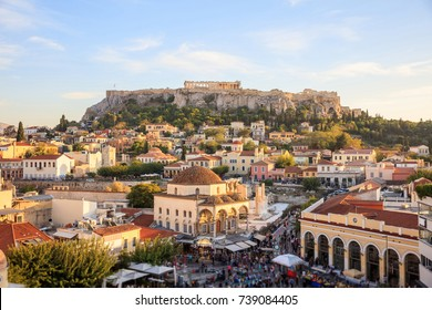 Athens, Greece. Acropolis rock and Monastiraki square at afternoon, blue sky background