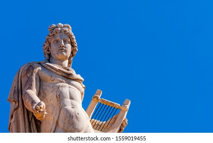 Athens Greece, Apollo ancient god of poetry and music marble statue on plain background, space for your text