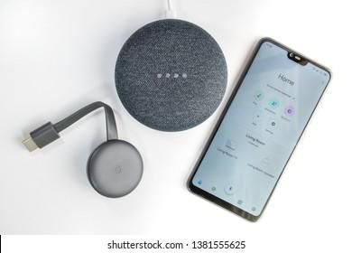 Athens, Greece - April 24 2019: Google Home Mini, Chromecast and Home app on a smartphone