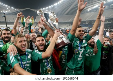 ATHENS, GREECE APRIL 26, 2014 : Players of Panathinaikos lift the Cup in front of their fans after their win over Paok during the Greek Cup Final match Paok vs Panathinaikos