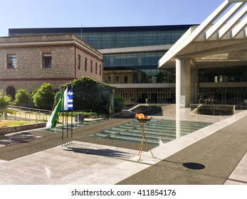 ATHENS, GREECE - APRIL 27, 2016: The Olympic flame on its way to the Rio de Janeiro Summer Olympics, makes a brief stop in front of the New Acropolis Museum.