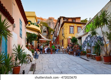 Athens, Greece - August 20, 2016: People in a coffee shop in the old town of Plaka under Acropolis, Athens.