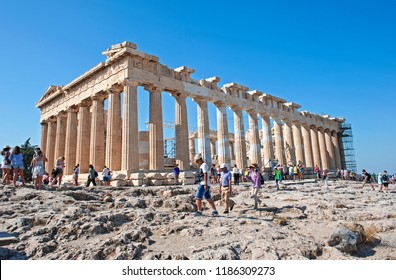 Athens, Greece - August 31, 2018: Tourist visiting and taking photos in front of Parthenon on the Acropolis in Athens, Greece