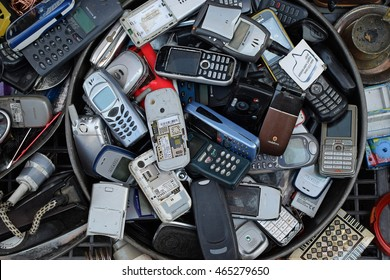 ATHENS, GREECE - AUGUST 4, 2016: Old mobile cell phones. Pile of broken handphones for sale at junk shop.