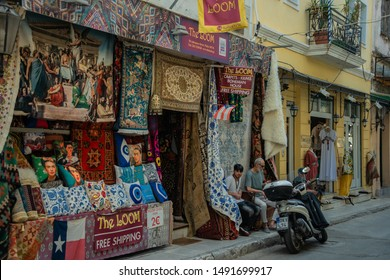 Athens, Greece - August 4, 2019: Tourists and local Greeks shop at the outdoor shopping center and marketplace near the Monastraki and Plaka district in Athens Greece