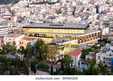 ATHENS, GREECE- AUGUST 6, 2009: Cityscape with the New Acropolis museum building illuminated at dusk as viewed from the Acropolis