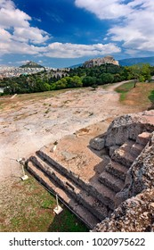 """ATHENS, GREECE.The """"Bema"""" or """"Vema""""  (""""stepping stone"""" or speakers' platform) of Pnyx, where popular assemblies were taking place in Ancient Athens. In the background, the Acropolis."""