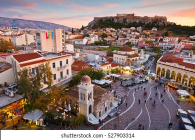 Athens, Greece - December 01, 2016:  View of Acropolis from a roof-top coffee shop in Monastiraki square, Athens.
