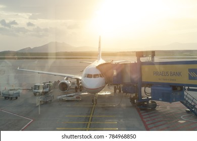 Athens, Greece. December 03, 2017: Airport with airplane at beautiful sunrise.