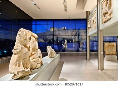 ATHENS, GREECE- December 12, 2011. Inside view of the (new) Acropolis museum (part of the Parthenon gallery on the 3rd floor). In the background, through the glass you can see the Acropolis.