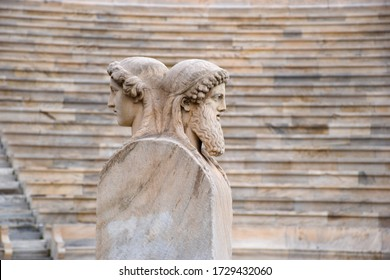 ATHENS, GREECE - DECEMBER 23 2016:  Two-sided Herms stone sculpture inside Panathenaic Stadium, where the first Olympic Games of modern times took place in 1896