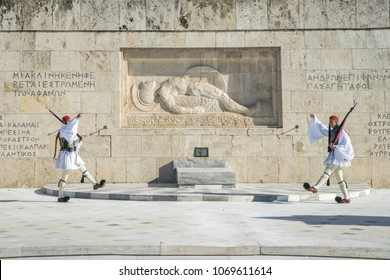 Athens, Greece - December 31 2017 : Changing of the guard in front of the Tomb of the Unknown Soldier which is located in front of the Greek Parliament Building on Syntagma Square.