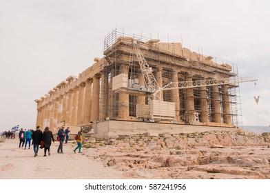 ATHENS, GREECE - FEBRUAR 19, 2017: Restoration of Athena Partenon temple, Acropolis. Religious building of ancient times.
