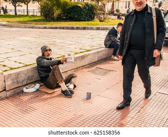 Athens, Greece - Februar 21, 2017: An old Greek beggar waits for alms on a street.