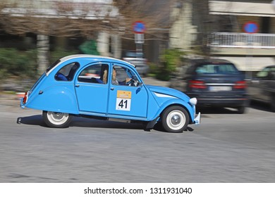 ATHENS, GREECE, FEBRUARY 10, 2019. Panning shot of classic french car Citroen 2CV of 1978, at a street circuit in a suburb of Athens.