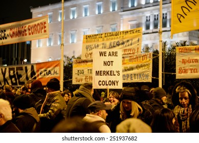 Athens Greece February 11, 2015 Protesters with signs during an anti-austerity, pro-government demonstration outside the Greek parliament on the eve of a crucial euro zone finance ministers meeting.