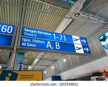 Athens, Greece - February, 11 2020: Athens International Airport Eleftherios Venizelos. An information board for passengers, direction sign to gates and check-in in the departure hall of the main