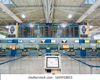 Athens, Greece - February, 11 2020: Athens International Airport Eleftherios Venizelos. An empty departure hall of the main terminal, empty check-in desks and a departure display with advertising of