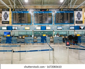 Athens, Greece - February, 11 2020: Athens International Airport Eleftherios Venizelos. An empty departure hall of the main terminal, empty check-in desks with only some people at registration and a