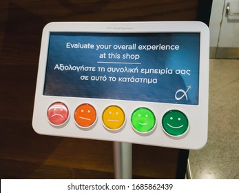 Athens, Greece - February, 11 2020: Customer service evaluation and satisfaction survey in Athens International Airport Eleftherios Venizelos. Colorful service reaction and feedback assessment monitor