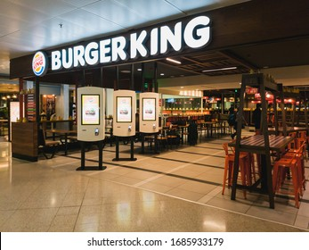 Athens, Greece - February, 11 2020: An empty Burger King restaurant inside the departure hall of Athens International Airport Eleftherios Venizelos. Burger King is an American multinational chain of
