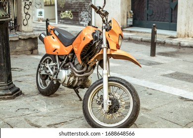 Athens, Greece - February 14, 2020. vintage motorcycle parked on old street of Athens