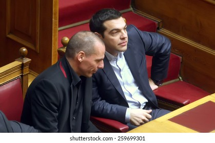 ATHENS, GREECE - FEBRUARY 18,2015: Prime Minister Alexis Tsipras (R) talks with Finance Minister Yanis Varoufakis (L) at the Parliament during the voting session for President of Greece